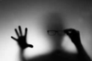 stock-photo-ghost-glasses-the-ghost-behind-the-frosted-glass-with-glasses-208029601